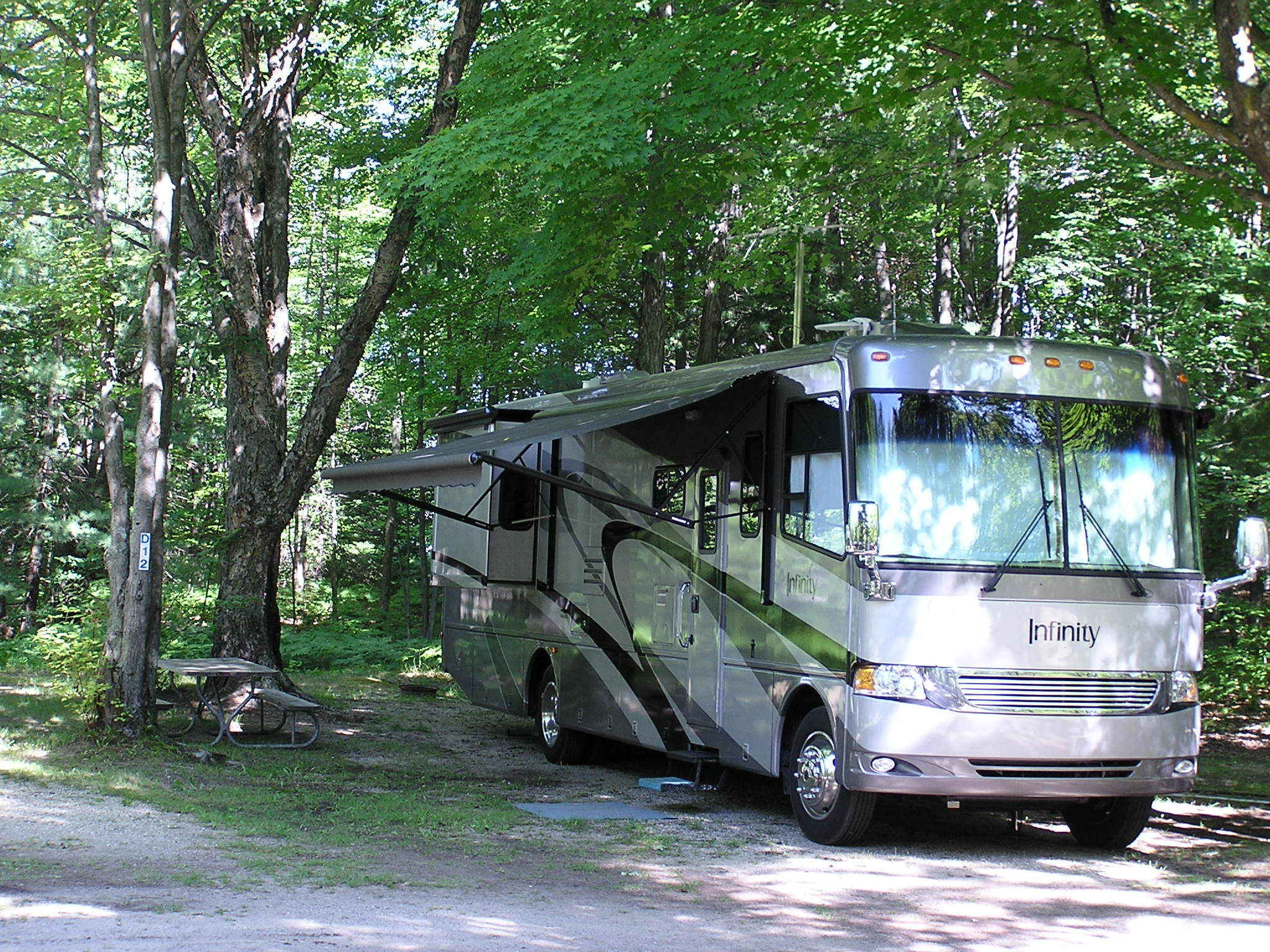 Many Large Back In Or Pull Thru Sites For Larger RVs Nice Wooded And Some With Cement Pads Cable TV Available On All Full Hook Up